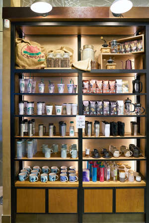 SEOUL, SOUTH KOREA - CIRCA MAY, 2017: goods on display at Starbucks coffee shop in Seoul. Starbucks Corporation is an American coffee company and coffeehouse chain. Editorial
