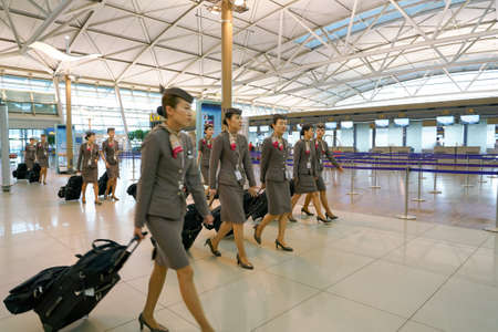 INCHEON, SOUTH KOREA - CIRCA JUNE, 2017: Asiana Airlines crew members at Incheon International Airport. Editorial
