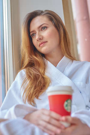 SAINT PETERSBURG, RUSSIA - CIRCA APRIL, 2017: woman with cup of coffee from Starbucks