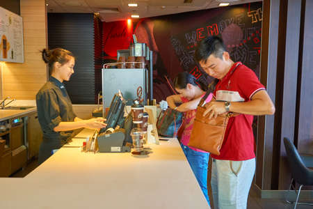 SHENZHEN, CHINA - CIRCA OCTOBER, 2015: people buy coffee at McCafe. McCafe is a coffee house style food and drink chain, owned by McDonalds.
