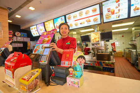 SHENZHEN, CHINA - CIRCA OCTOBER, 2015: indoor portrait of staff at McDonalds in Shenzhen. McDonalds is an American hamburger and fast food restaurant chain.