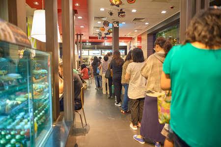 HONG KONG - OCTOBER 25, 2015: people queue to make order at McDonald's restaurant. McDonald's primarily sells hamburgers, cheeseburgers, chicken, french fries, breakfast items, soft drinks, milkshakes, and desserts