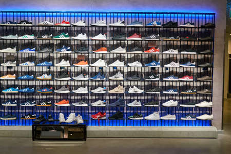 SAINT PETERSBURG, RUSSIA - CIRCA AUGUST, 2017: inside Adidas store at Galeria shopping center. Adidas AG is a German multinational corporation, that designs and manufactures shoes, clothing and accessories. Editorial
