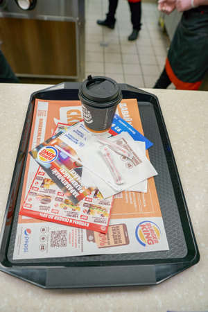 SAINT PETERSBURG - CIRCA OCTOBER, 2017: tray with coffee cup at Burger King restaurant. Burger King is an American global chain of hamburger fast food restaurants.