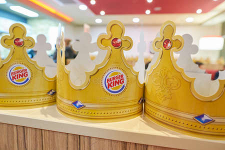 SAINT PETERSBURG - CIRCA OCTOBER, 2017: paper crowns at Burger King restaurant. Burger King is an American global chain of hamburger fast food restaurants. Editorial