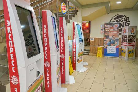 SAINT PETERSBURG - CIRCA OCTOBER, 2017: self ordering kiosks at Burger King restaurant. Burger King is an American global chain of hamburger fast food restaurants. Editorial