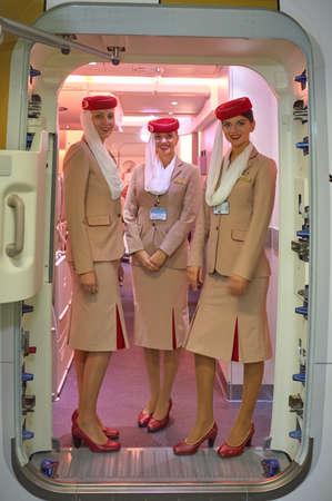 DUBAI, UAE - NOVEMBER 22, 2015: Emirates cabin crew attendants on board of Airbus A380.