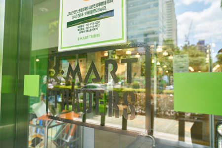 BUSAN, SOUTH KOREA - CIRCA MAY, 2017: close up shot of E-Mart Traders sign in Busan. E-Mart Traders is a warehouse-style retail store that sells products directly imported from famous global brands. Editorial