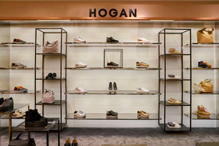 ROME, ITALY - CIRCA NOVEMBER, 2017: Hogan shoes on display at a second flagship store of Rinascente in Rome. Редакционное
