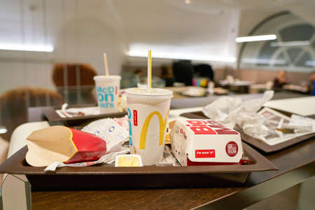 ROME, ITALY - CIRCA NOVEMBER, 2017: left food tray at McDonalds restaurant. McDonalds is an American hamburger and fast food restaurant chain. Editorial