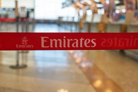 MILAN MALPENSA, ITALY - CIRCA NOVEMBER, 2017: close up shot of Emirates Airlines sign at check-in area in Milan-Malpensa airport, Terminal 1.