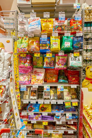 ROME, ITALY - CIRCA NOVEMBER 2017: an assortment of candy and chocolate in Carrefour Express store in Rome. Carrefour Express is a convenience store chain owned and operated by French retailer Carrefour.