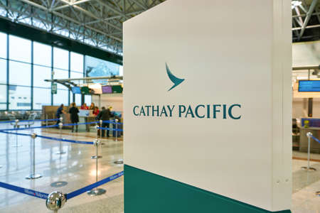 MILAN MALPENSA, ITALY - CIRCA NOVEMBER, 2017: close up shot of Cathay Pacific sign at check-in area in Milan-Malpensa airport, Terminal 1.