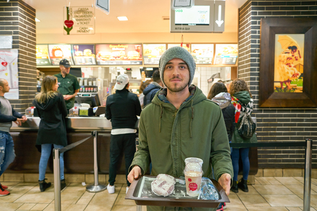 ROME, ITALY - CIRCA NOVEMBER, 2017: portrait of customer with tray at McDonalds restaurant in Rome.
