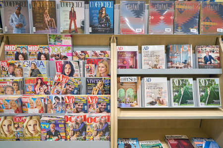MILAN MALPENSA, ITALY - CIRCA NOVEMBER, 2017: magazines on display at a Hudson News store in Milan-Malpensa Airport. Hudson Group, one of the largest travel retailers in North America.