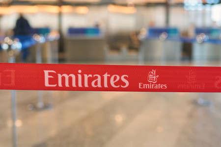MILAN MALPENSA, ITALY - CIRCA NOVEMBER, 2017: close up shot of Emirates Airlines sign at Milan-Malpensa airport, Terminal 1.