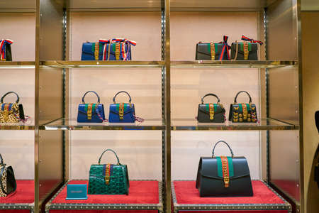 MILAN, ITALY - CIRCA NOVEMBER, 2017: Gucci bags on display at Rinascente. Rinascente is a collection of high-end stores. 写真素材 - 119937096
