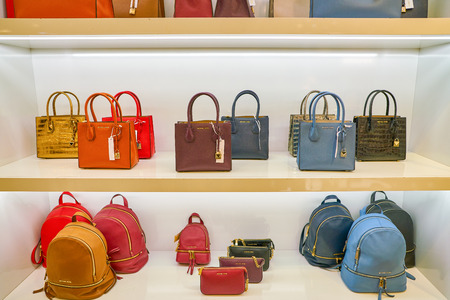 MILAN, ITALY - CIRCA NOVEMBER, 2017: Michael Kors bags on display at Rinascente. Rinascente is a collection of high-end stores.