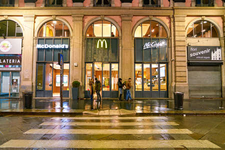 MILAN, ITALY - CIRCA NOVEMBER, 2017: a McDonald's restaurant in Milan at night.