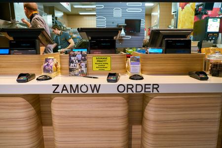 WARSAW, POLAND - CIRCA NOVEMBER, 2017: close up shot of a counter at McDonalds Restaurant at Warsaw Frederic Chopin Airport.