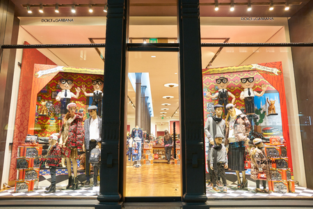 MILAN, ITALY - CIRCA NOVEMBER, 2017: a window display and entrance at Dolce & Gabbana store in Milan. Dolce & Gabbana is an Italian luxury fashion house. Editorial