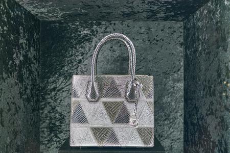 MILAN, ITALY - CIRCA NOVEMBER, 2017: bag on display at Michael Kors store in Milan. Michael Kors Holdings Limited is an American fashion company.