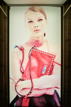 MILAN, ITALY - CIRCA NOVEMBER, 2017: close up shot of Prada advertisement in Milan. Prada S.p.A. is an Italian luxury fashion house. Editorial