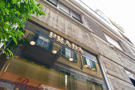 MILAN, ITALY - CIRCA NOVEMBER, 2017: Prada brand name over a display window at a store in Milan. Prada S.p.A. is an Italian luxury fashion house.