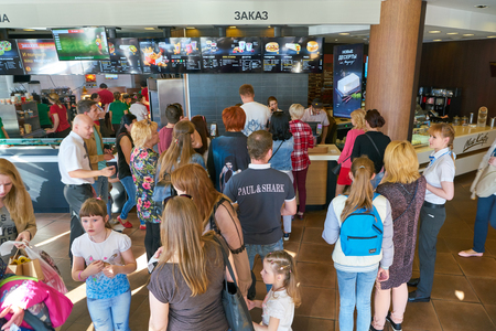 NIZHNY NOVGOROD, RUSSIA - CIRCA MAY, 2018: people in McDonalds restaurant. McDonalds is an American hamburger and fast food restaurant chain. Editorial