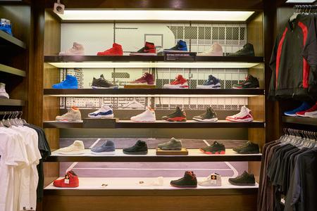 MILAN, ITALY - CIRCA NOVEMBER, 2017: inside Foot Locker store in Milan. Foot Locker Retail, Inc. is an American sportswear and footwear retailer Publikacyjne