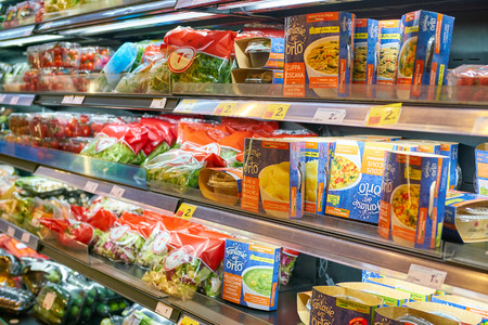 MILAN, ITALY - CIRCA NOVEMBER, 2017: assortment of food on display for sale at Carrefour Express in Milan.