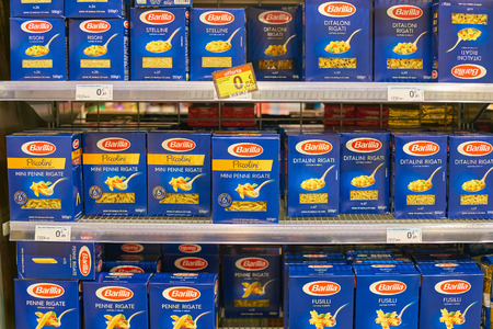 MILAN, ITALY - CIRCA NOVEMBER, 2017: assortment of pasta on display for sale at Carrefour Express in Milan. Editorial