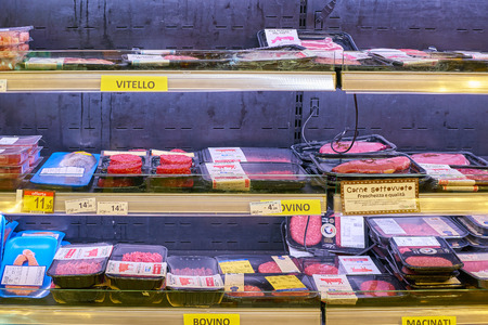 MILAN, ITALY - CIRCA NOVEMBER, 2017: assortment of meat products on display for sale at Carrefour Express in Milan.