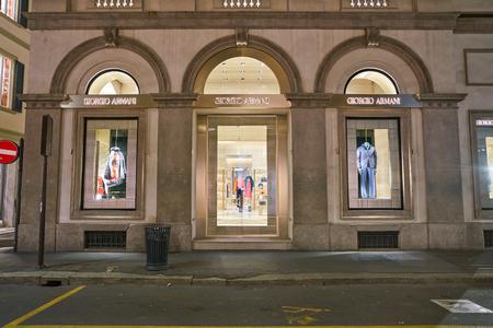 MILAN, ITALY - CIRCA NOVEMBER, 2017: entrance and display windows at Giorgio Armani store in Milan. Editorial