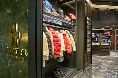 ROME, ITALY - CIRCA NOVEMBER, 2017: interior shot of a Moncler store in Fiumicino International Airport. Moncler is an Italian apparel manufacturer and lifestyle brand. Stock fotó - 119938714