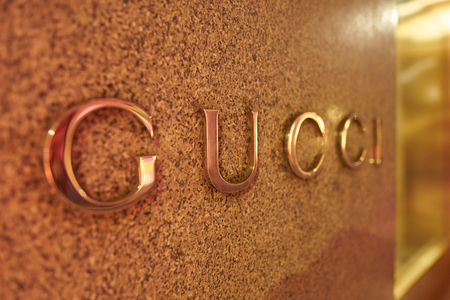 MILAN, ITALY - CIRCA NOVEMBER, 2017: close up shot of Gucci sign. Gucci is an Italian luxury brand of fashion and leather goods.