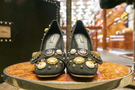 MILAN, ITALY - CIRCA NOVEMBER, 2017: shoes on display at Dolce & Gabbana store in Milan. Dolce & Gabbana is an Italian luxury fashion house.