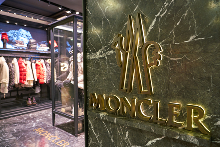 ROME, ITALY - CIRCA NOVEMBER, 2017: close up shot of Moncler sign at a store in Fiumicino International Airport. Moncler is an Italian apparel manufacturer and lifestyle brand. Фото со стока - 119934181