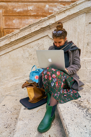 ROME, ITALY - CIRCA NOVEMBER, 2017: woman sit on Spanish Steps in Rome. Rome is the capital city of Italy. Editorial