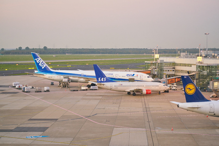 DUSSELDORF, GERMANY - CIRCA OCTOBER, 2018: aircrafts on tarmac at Dusseldorf Airport.