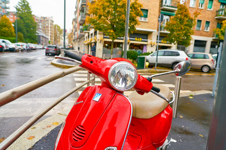 MILAN, ITALY - CIRCA NOVEMBER, 2017: parked red Vespa in Milan. Milan is a city in northern Italy. Editorial