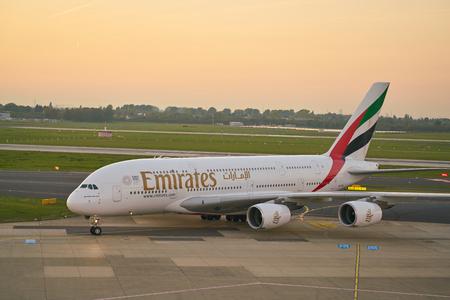 DUSSELDORF, GERMANY - CIRCA OCTOBER, 2018: Emirates Airbus A380-800 taxi at Dusseldorf Airport. 報道画像