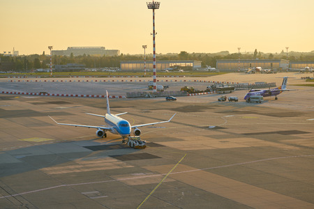 DUSSELDORF, GERMANY - CIRCA OCTOBER, 2018: KLM Cityhopper aircraft on pushback at Dusseldorf Airport.