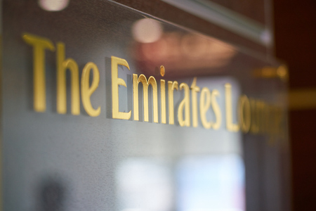 DUSSELDORF, GERMANY - CIRCA SEPTEMBER, 2018: close up shot of The Emirates Lounge sign in Dusseldorf airport.