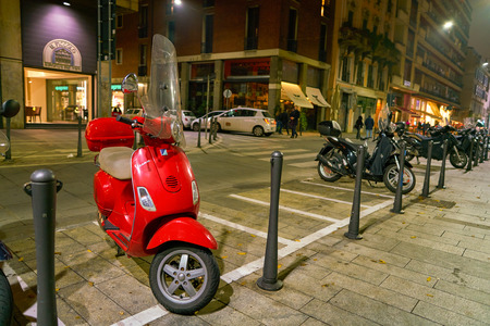 MILAN, ITALY - CIRCA NOVEMBER, 2017: parked motor scooters in Milan. Milan is a city in northern Italy.