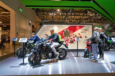 MILAN, ITALY - NOVEMBER 11, 2017: visitors try out a motorcycle at the EICMA 2017 - 75th International Motorcycle Exhibition.