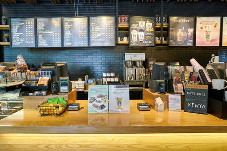BUSAN, SOUTH KOREA - CIRCA MAY, 2017: sales area at Starbucks coffee shop in Busan. Starbucks Corporation is an American coffee company and coffeehouse chain.
