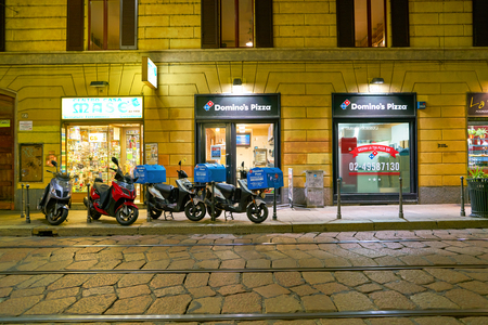 MILAN, ITALY - CIRCA NOVEMBER, 2017: Domino's Pizza in Milan. Domino's is an American pizza restaurant chain Editorial