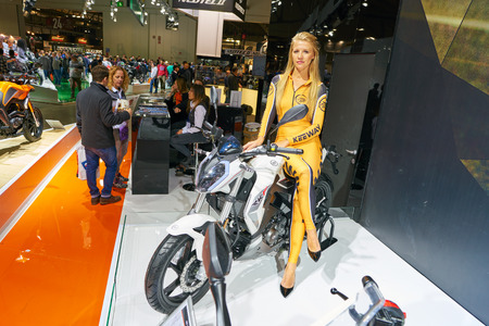 MILAN, ITALY - NOVEMBER 11, 2017: a model poses for the visitors during the EICMA 2017 - 75th International Motorcycle Exhibition. Editorial