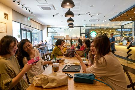 BUSAN, SOUTH KOREA - CIRCA MAY, 2017: inside Starbucks coffee shop in Busan. Starbucks Corporation is an American coffee company and coffeehouse chain. Editoriali